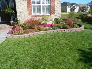 Custom Retaining Wall Design Dawn to Dusk Landscape
